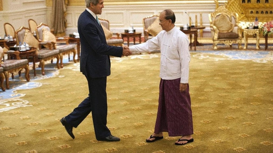 U.S. Secretary of State John Kerry, left,  shakes hands with Myanmar President Thein Sein during their meeting at the Presidential hall outside the venue of the 47th ASEAN Foreign Ministers' Meeting in Naypyidaw Saturday, Aug. 9, 2014. (AP Photo/Nicolas Asfouri, Pool)