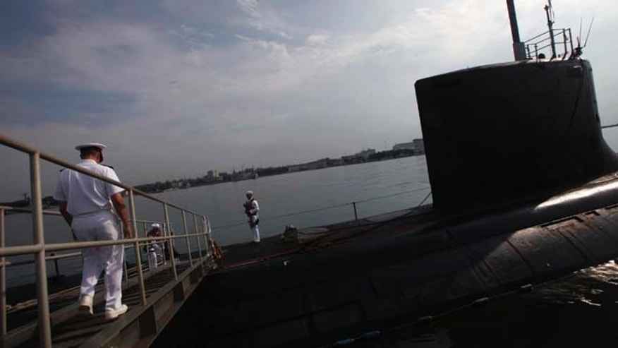 FILE: USS North Carolina is a VIrginia-class submarine docked at Changi Naval Base in Singapore. The Russian navy believes it chased a similar sub from the Barents Sea, according to reports.