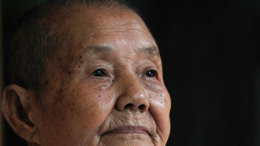 In this July 3, 2014 photo, Som Seng Eath, 86, widow of a dairy writer Poch Younly, pauses during an interview with the Associated Press in her home, in Phnom Penh, Cambodia. Nearly 40 years ago, Cambodian school inspector Poch Younly kept a secret diary vividly recounting the horrors of life under the Khmer Rouge, the radical communist regime whose extreme experiment in social engineering took the lives of 1.7 million Cambodians who died of overwork, medical neglect, starvation and execution.(AP Photo/Heng Sinith)