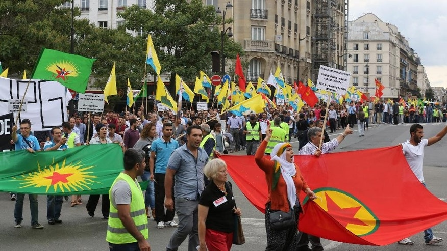 Kurdish demonstrators staged a protest in Paris, Saturday Aug. 9, 2014, in support of  Kurds and Christians living in Iraq.  Tens of thousands of Iraqi Christians and ethnic minorities are facing potential slaughter by Islamist militants in Iraq. (AP Photo/Remy de la Mauviniere)