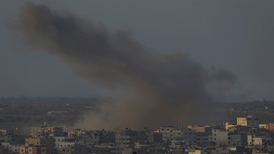August 10, 2014: Smoke from an Israeli strike rises over Gaza City.  (AP Photo/Lefteris Pitarakis)