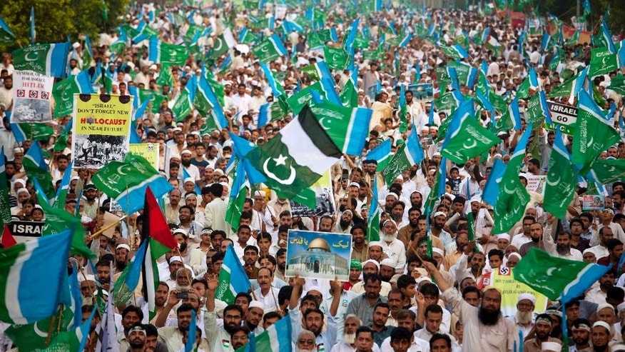 Thousands of supporters of Pakistani religious party Jamaat-e-Islami take part in a rally against the Israeli bombings in the Gaza Strip, in Islamabad, Pakistan, Sunday, Aug. 10, 2014. (AP Photo/Anjum Naveed)