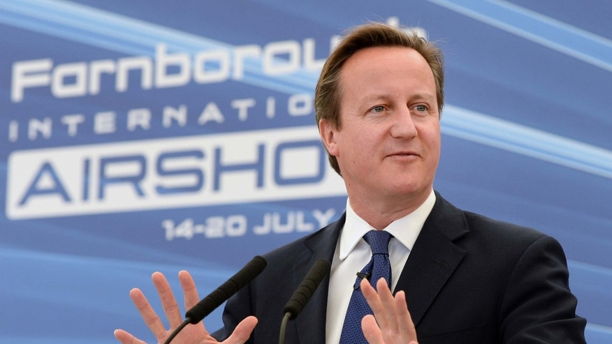 B July 14, 2014 - FILE photo of Britain's Prime Minister David Cameron, during a visit to the 2014 Farnborough Airshow, in Hampshire, England.  Pressure is mounting for Cameron to do more on Iraq, with some members of his own party urging him to recall Parliament from its summer break to consider action against Islamic militants.