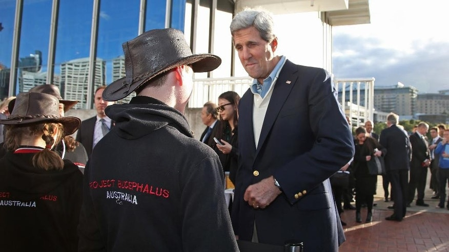U.S. Secretary of State John Kerry right, chats with school children while visiting the National Maritime Museum in Sydney, Monday, Aug. 11, 2014. Kerry and US Secretary of Defense Chuck Hagel are in Sydney for the annual Australia-United States Ministerial (AUSMIN) talks. (AP Photo/Rick Rycroft)