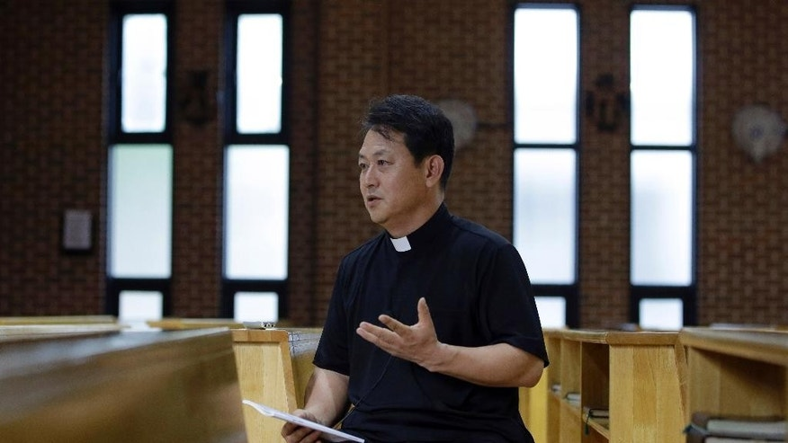 "In this photo taken on Monday, July 28, 2014, Rev. Park Geun Tae speaks during an interview at a Seoul Catholic church in Seoul, South Korea. Park said the emergence of Catholicism in Korea was seen by some as liberation from a system where some of the lowest-class believers had been ""treated like animals."" Catholics were persecuted for allegedly disrupting the social order, plotting treason, denying the Joseon Dynasty's legitimacy and seeking help from foreign powers to spread Christianity. The 124 Korean Catholic martyrs who will be honored by Pope Francis this week left behind families who were in the dark about their sacrifices for generations, and in some cases now live as Buddhists or Protestants. Francis on Thursday, Aug. 14, makes the first papal visit to South Korea in 25 years and is expected to praise the martyrs he plans to beatify in the last formal step before sainthood.  (AP Photo/Lee Jin-man)"