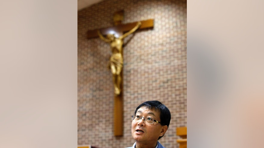 In this photo taken on Monday, July 28, 2014, Paul Yoon, a 56-year-old who runs a business supplying electronic products to U.S. army bases, speaks during an interview at a Seoul Catholic church in Seoul, South Korea. Yoon said he only found out about his relation to a martyr about seven years ago, after his wife discovered lineage records. The 124 Korean Catholic martyrs who will be honored by Pope Francis this week left behind families who were in the dark about their sacrifices for generations, and in some cases now live as Buddhists or Protestants. Francis on Thursday, Aug. 14, makes the first papal visit to South Korea in 25 years and is expected to praise the martyrs he plans to beatify in the last formal step before sainthood. (AP Photo/Lee Jin-man)