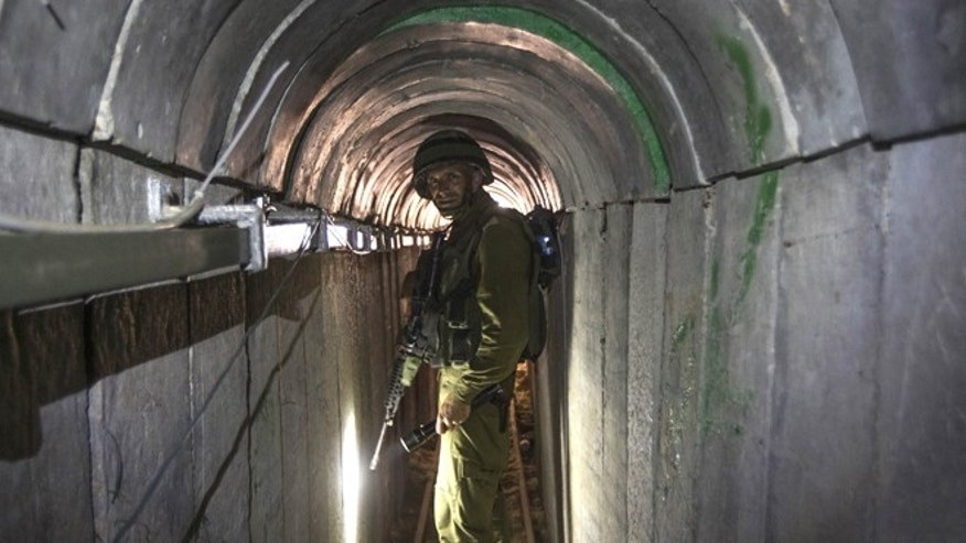 July 25, 2014: In this file photo, an Israeli army officer gives journalists a tour of a tunnel allegedly used by Palestinian militants for cross-border attacks, at the Israel-Gaza Border. (AP)