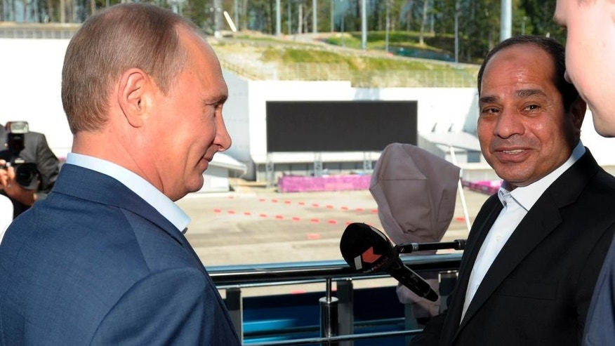 Russian President Vladimir Putin, left, meets with Egyptian President Abdel-Fattah el-Sissi, right, in the Russian Black Sea resort of Sochi, Russia, Tuesday, Aug. 12, 2014. El-Sissi is on his first visit to Russia. (AP Photo/RIA Novosti, Alexei Druzhinin, Presidential Press Service)
