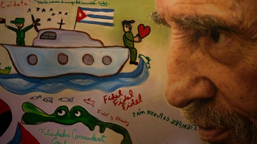 An image of Fidel Castro painted by children with motifs of the revolution and scribbled with happy birthday messages is seen during an exhibition of photographs of Fidel Castro by photographer Roberto Chile at the Jose Marti Memorial in Havana, Cuba, Tuesday, Aug. 12, 2014. Castro will celebrate his 88th birthday on Wednesday. (AP Photo / Ramon Espinosa)