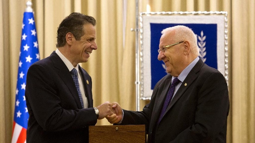 Israel's President Reuven Rivlin shakes hands with New York Gov. Andrew Cuomo during their meeting at the President's residence in Jerusalem, Wednesday, Aug. 13, 2014. (AP Photo/Sebastian Scheiner)