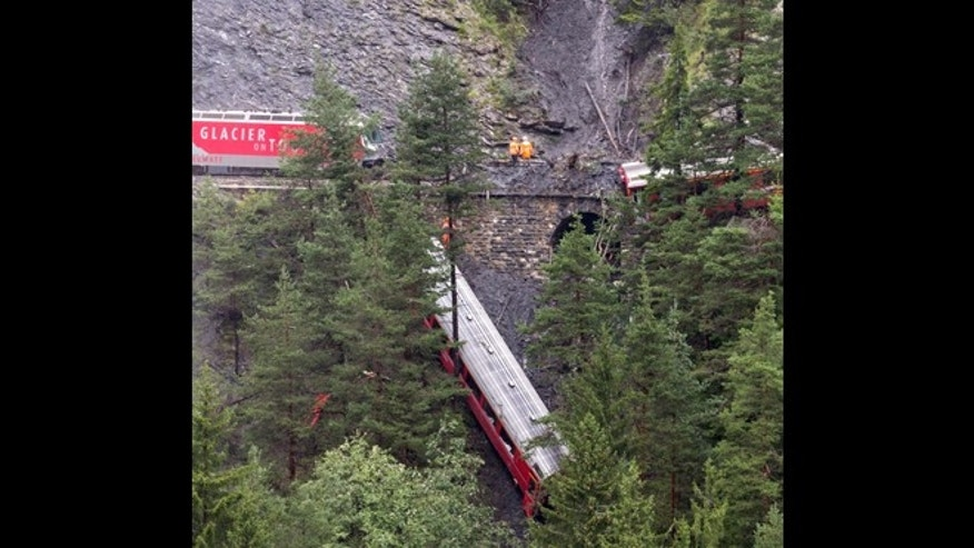 Aug. 13, 2014: A derailed passenger train is pictured near Tiefencastel, Switzerland.