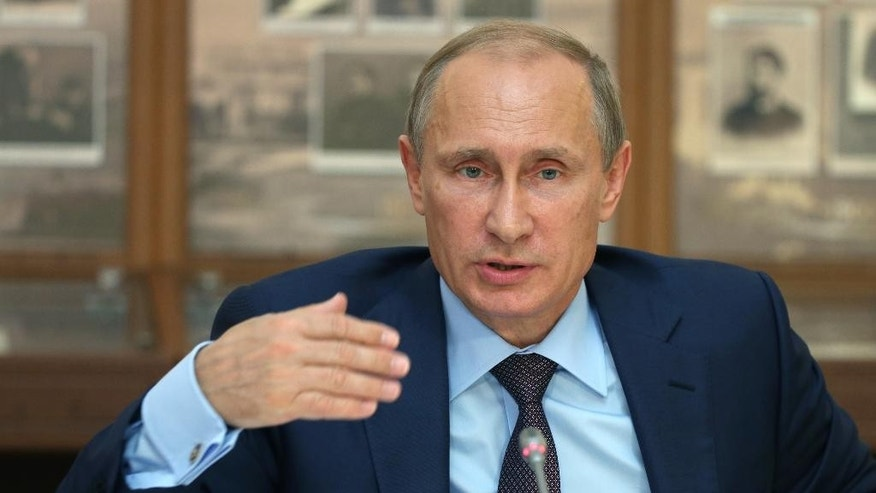Russian President Vladimir Putin pauses, during a meeting with cultural figures at Chekhov museum in the Black Sea resort of Yalta, Crimea, Thursday, Aug. 14, 2014.  Putin addressed hundreds of lawmakers Thursday in Yalta in Crimea, which was annexed by Russia from Ukraine in March. (AP Photo/Sergei Chirikov, Pool)