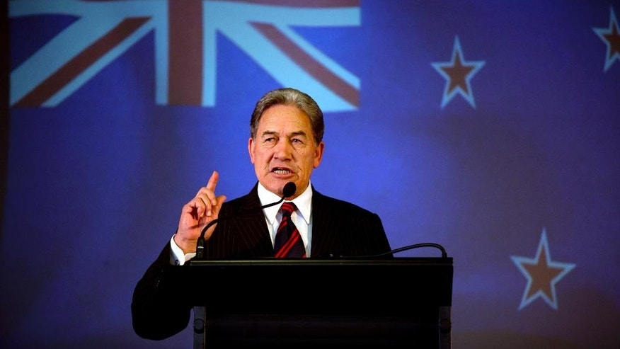 "In this Sunday, Aug. 10, 2014 photo, New Zealand First leader Winston Peters speaks at the party campaign launch at the Kelston Community Hall in Auckland, New Zealand. At the campaign launch for the anti-immigration New Zealand First party, Peters lit into the government for allowing farms to be sold to foreign buyers, including those from China. ""As they say in Beijing, two Wongs don't make a white,"" he said, drawing laughter from his Auckland audience but condemnation elsewhere. (AP Photo/New Zealand Herald, Dean Purcell) NEW ZEALAND OUT, AUSTRALIA OUT"