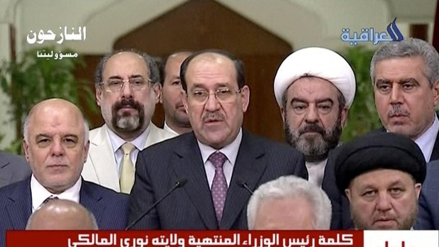 "In this image taken from video, Iraq's prime minister  for the past eight years, Nouri al-Maliki,  relinquishes his post to fellow Dawa Party member Haider al-Abadi, Thursday, Aug. 14, 2014, ending a political deadlock that has plunged the country into uncertainty as it fights a Sunni militant insurgency. Al-Maliki said the decision to back al-Abadi reflected his desire to ""safeguard the high interests of the country,"" adding that he would not be the cause of any bloodshed. (AP Photo/Al Iraqiya via Associated Press Television) IRAQ OUT"