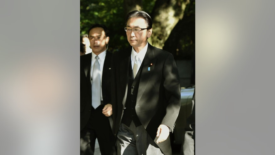 Japan's National Public Safety Commission Chairman Keiji Furuya arrives at Yasukuni Shrine in Tokyo Friday, Aug. 15, 2014. Japan marks the 69th anniversary of its Aug. 15, 1945 surrender in World War II. The shrine honors 2.5 million war dead, including Class A war criminals.  (AP Photo/Kyodo News) JAPAN OUT
