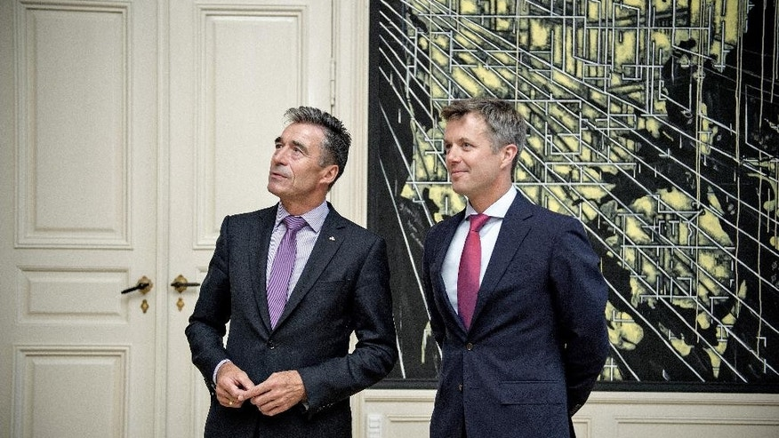 NATO Secretary General Anders Fogh Rasmussen meets Danish Crown Prince Frederik, right, during his official visit to Denmark on Friday, Aug. 15, 2014. (AP Photo/POLFOTO, Jens Dresling)  DENMARK OUT