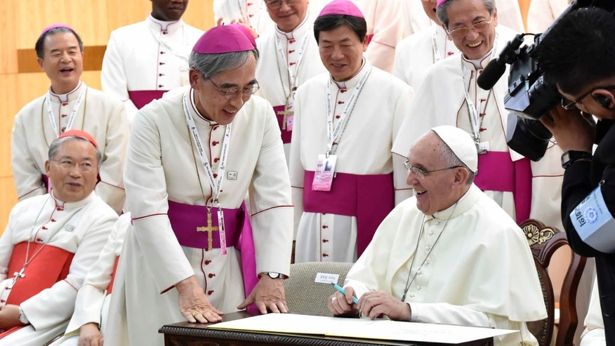Aug. 14, 2014 - Pope Francis, right, meeting with the bishops of Korea at the headquarters of the Korean Episcopal Conference in Seoul, South Korea.