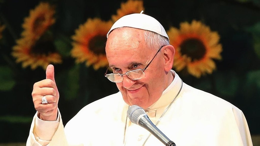 "Pope Francis gives a thumbs up during a meeting with Asian youth at the Solmoe Sanctuary in Dangjin, South Korea, Friday, Aug. 15, 2014. Pope Francis urged Catholic youth on Friday to renounce the materialism that afflicts much of Asian society today and reject ""inhuman"" economic systems that disenfranchise the poor, pressing his economic agenda in one of the region's powerhouses where financial gain is a key barometer of success. (AP Photo/Ahn Young-joon, Pool)"