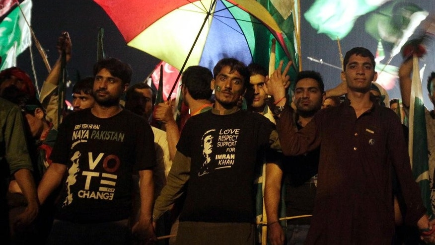 Supporters of Pakistan's cricketer-turned-politician Imran Khan take part in an anti government rally in Islamabad, Pakistan, Saturday, Aug. 16, 2014. Tens of thousands of anti-government protesters gathered in Pakistan's capital Islamabad late Friday in the pouring rain following the arrival of convoys led by Khan and a fiery anti-Taliban cleric. (AP Photo/Anjum Naveed)