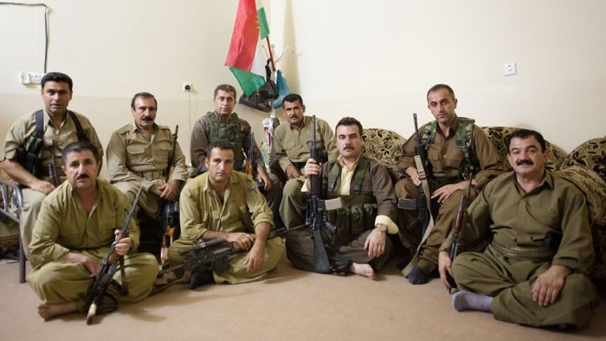 "Gen. Abdula Musla (back row, second from left), also known as the ""Dark Lion,"" is perhaps the peshmerga's most decorated warrior. (Matt Cetti-Roberts)"