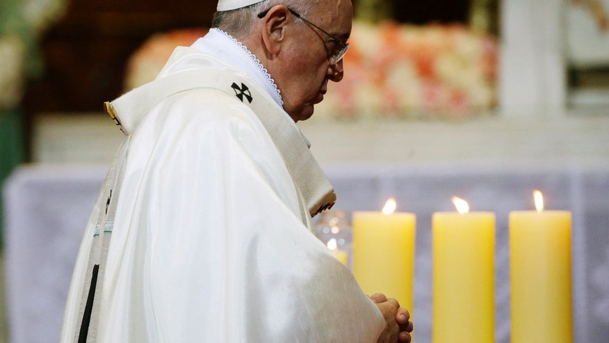 Aug. 18, 2014 - Pope Francis celebrates a Mass of reconciliation at Seoul's main cathedral, in South Korea.  Pope Francis wrapped up his first trip to Asia on Monday.