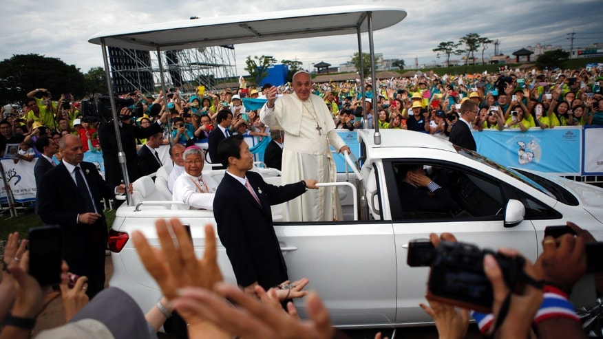 Aug. 17, 2014 - Pope Francis waves to the faithful as he arrives for a closing Holy Mass of the 6th Asian Youth Day in Haemi, South Korea.