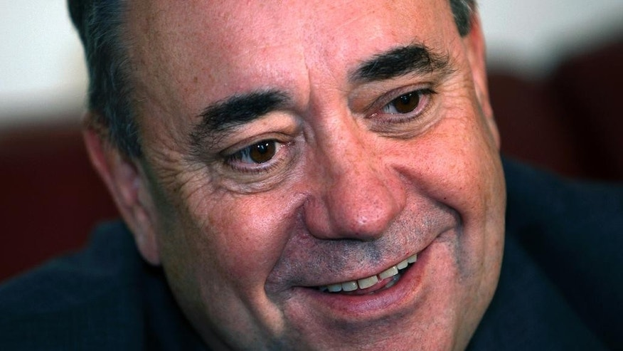 Scottish First Minister Alex Salmond during an interview with The Associated Press during a visit to a house building project in Arbroath on the East coast of Scotland Monday, Aug. 18, 2014. Two opinion polls show that Scotland's voters are narrowly divided on whether to leave the United Kingdom one month before a referendum. Sunday's published polls both found that a majority of decided voters want Scotland to stay within the UK alongside England, Wales and Northern Ireland. (AP Photo/Martin Cleaver)
