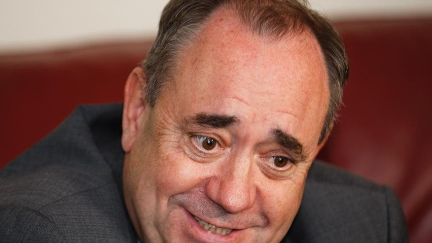 Scottish First Minister Alex Salmond speaks to The Associated Press during a visit to a house building project in Arbroath on the East coast of Scotland Monday, Aug. 18, 2014. Two opinion polls show that Scotland's voters are narrowly divided on whether to leave the United Kingdom one month before a referendum. Sunday's published polls both found that a majority of decided voters want Scotland to stay within the UK alongside England, Wales and Northern Ireland. (AP Photo/Martin Cleaver)