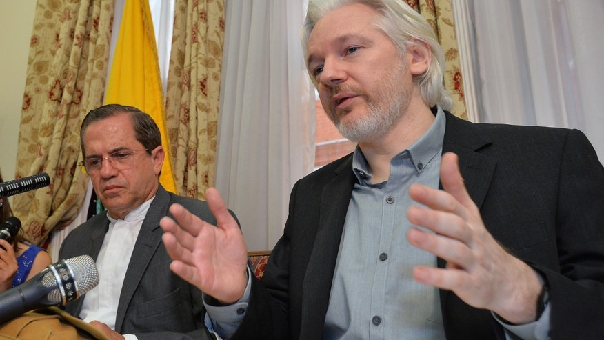 "Aug. 18, 2014 - Ecuador's Foreign Minister Ricardo Patino, left, and WikiLeaks founder Julian Assange at a press conference at the Ecuadorian Embassy in London. Assange confirmed he'll be ""leaving the embassy soon.""  The Australian Assange fled to the embassy in 2012 to escape extradition to Sweden, where he's wanted for sex crimes."