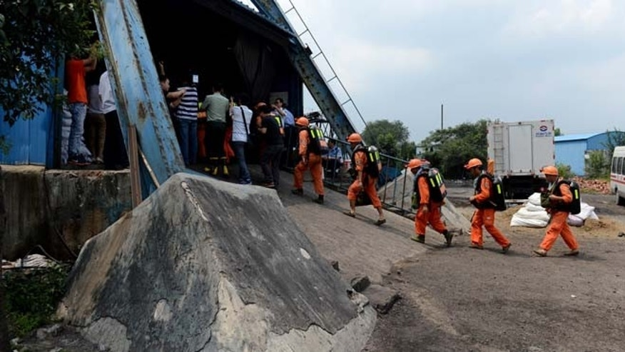 Aug. 19, 2014: In this photo, rescuers prepare to go into the Dongfang Coal Mine in Xiejiaji District of Huainan City, east China's Anhui Province. (AP)