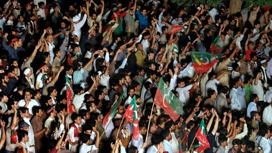 Aug. 18, 2014: Supporters of Pakistani cricketer-turned-politician Imran Khan chant slogans during a protest in Islamabad, Pakistan. Khan on Monday announced to lead thousands of anti-government protesters into the high security Red Zone as his 48 hours deadline for government to step down ending Tuesday.