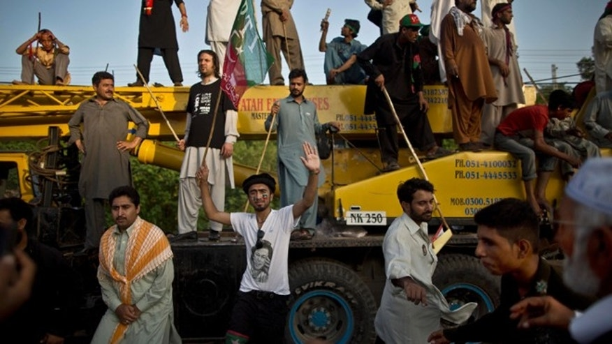 Aug. 19, 2014: Supporters of Pakistani cricketer-turned-politician Imran Khan dance on the lyrics of a song in Khan's support, during a protest in Islamabad, Pakistan.