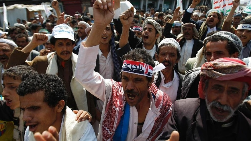 "Yemeni Shiite groups chant slogans during an anti-government demonstration in Sanaa, Yemen, Monday, Aug. 18, 2014. Arabic writing on headband reads,""no to fuel price hikes."" (AP Photo/Hani Mohammed)"