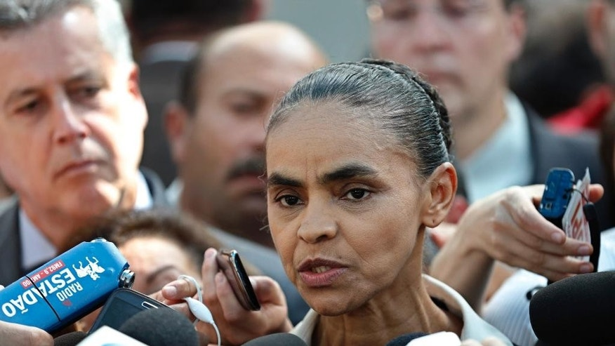 Brazilian Socialist Party (PSB) presidential candidate Marina Silva speaks to the press after attending a Mass in honor of late presidential candidate Eduardo Campos at the Metropolitan Cathedral in Brasilia, Brazil, Tuesday, Aug. 19, 2014. Campos was aboard a small private jet that crashed on Wednesday, Aug. 13 into a residential area in the southeastern port city of Santos. He had been running third in polls, and was replaced by environmentalist Marina Silva. (AP Photo/Eraldo Peres)