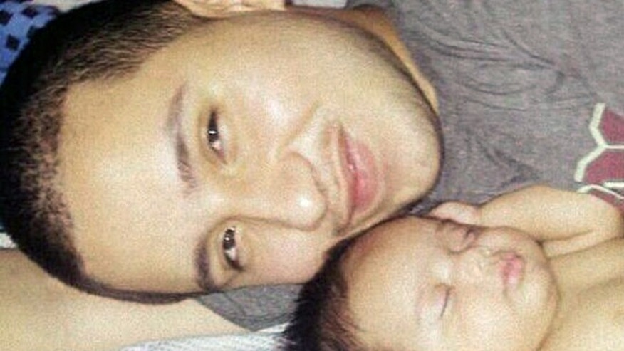 This undated photo provided by Felicia Leija shows Jose Banda, 20, with his newborn daughter Alisa. Authorities say Banda was fatally shot in December 2012 minutes after he slammed into a truck that was being pushed by a father and his two sons after the vehicle had broken down. The two boys were killed in the alcohol-related accident. Investigators allege the boys father, David Barajas, shot Banda. Barajas trial is set to begin Monday, Aug. 18.  (AP Photo/Felicia Leija)