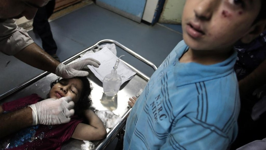 A wounded Palestinian girl receives treatment at the emergency room of the Shifa hospital following Israeli airstrikes in Gaza City, Tuesday, Aug. 19, 2014. Israel resumed its campaign of airstrikes in Gaza on Tuesday in response to a barrage of Palestinian rocket fire that shattered a truce. The sudden burst of fighting has threatened to derail an Egyptian effort to end a monthlong war between Israel and Hamas militants in Gaza. (AP Photo/Khalil Hamra)