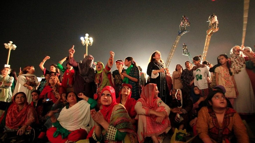 "Female supporters of Pakistan's cricketer-turned-politician Imran Khan shout slogans during a protest in Islamabad's high-security ""Red Zone,"" in Islamabad, Pakistan, Wednesday, Aug. 20, 2014. Pakistan's powerful army chief Gen. Rasheel Sharif asked the government to hold negotiations with protesters to settle a mass demonstration outside parliament, officials said. (AP Photo/Anjum Naveed)"