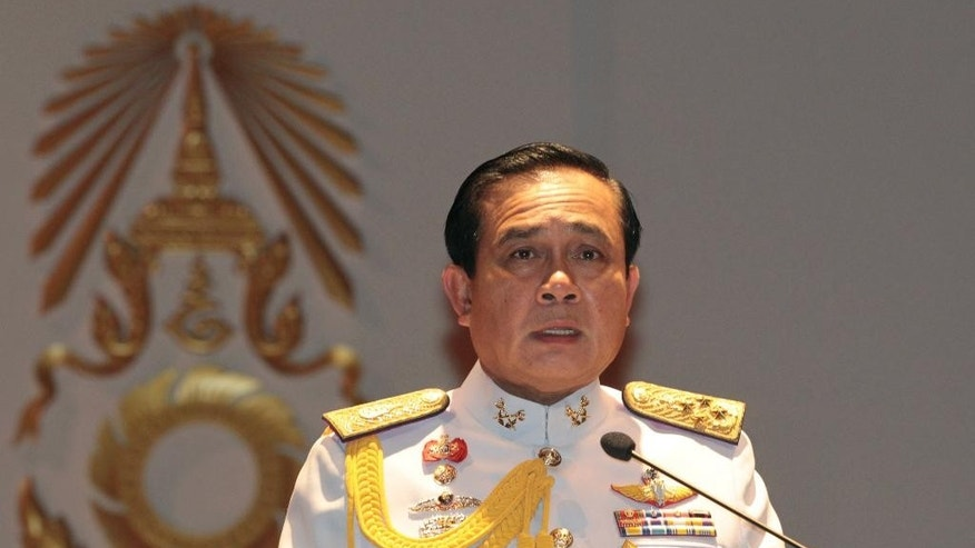 FILE - In this Monday, May 26, 2014 file photo, Gen. Prayuth Chan-ocha speaks at the start of his first press conference since Thursday's coup. Thailand's junta-appointed legislature voted unanimously Thursday to name Prayuth Chan-ocha to the post of of prime minister during a session in Bangkok. (AP Photo/Sakchai Lalit, File)