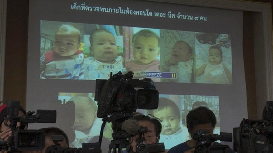 Aug. 12, 2014: Thai police display pictures of surrogate babies born to a Japanese man who is at the center of a surrogacy scandal during a press conference at the police headquarters in Chonburi, Thailand. (AP/Sakchai Lalit)