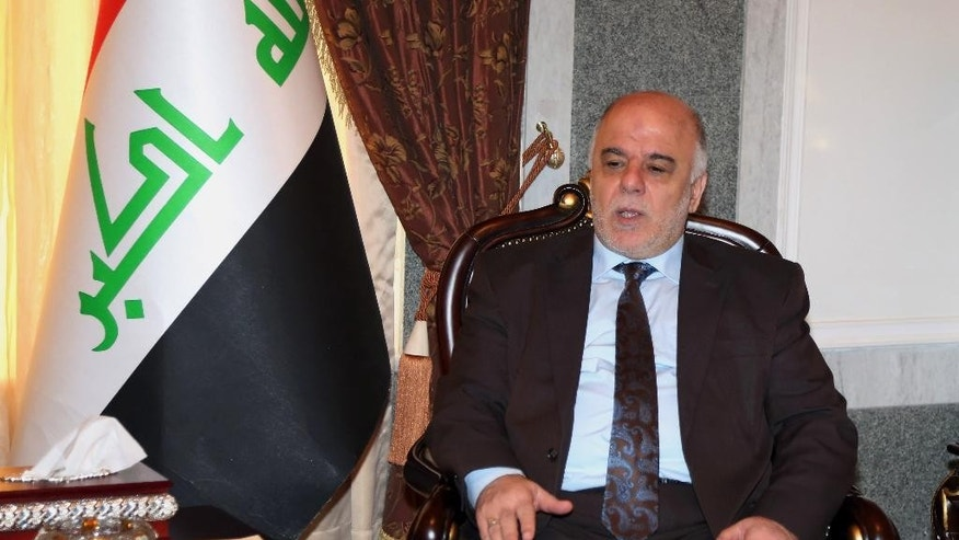 Iraqi premier-designate Haider al-Abadi meets with Pastor Farouk Yousuf in Baghdad, Iraq, Thursday, Aug. 21, 2014. Al-Abadi has until Sept. 11 to submit a list of Cabinet members to parliament for approval. Religious and ethnic minorities have called upon him to assemble an all-inclusive government. (AP Photo/Karim Kadim, Pool)
