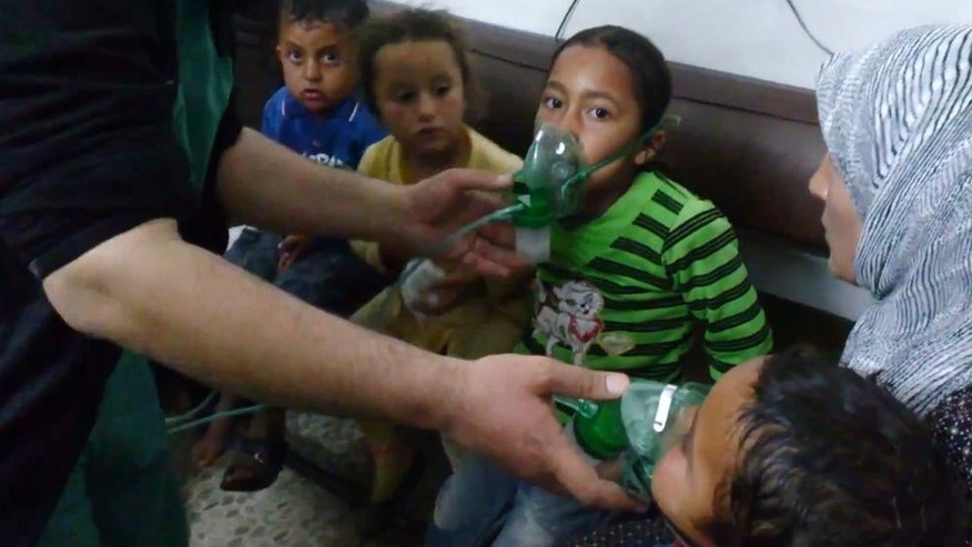 "FILE - In this image taken from video obtained from the Shaam News Network, posted on April 16, 2014, an anti-Bashar Assad activist group, which has been authenticated based on its contents and other AP reporting, children are seen receiving oxygen in Kfar Zeita, a rebel-held village in Hama province some 200 kilometers (125 miles) north of Damascus, Syria. An international human rights group says on the anniversary of the deadly chemical attack outside Damascus that ""justice remains elusive"" for the victims and their families. (AP Photo/Shaam News Network, File)"
