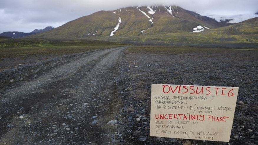 Aug. 19, 2014: A warning sign blocks the road to Bardarbunga volcano, some 12.5 miles away, in the north-west region of the Vatnajokull glacier.