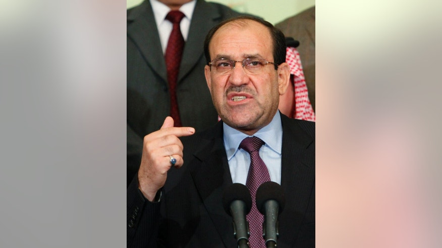 FILE - In this Friday, March 26, 2010 file photo, Iraqi Prime Minister Nouri al-Maliki speaks during a news conference in Baghdad, Iraq. The decision by al-Maliki to step down in August 2014 in favor of Haider al-Abadi, a fellow member of his Shiite Islamic Dawa Party, has raised hopes for a more inclusive government that can address Sunni grievances and present a united front against the Islamic extremists. (AP Photo/Hadi Mizban, File)