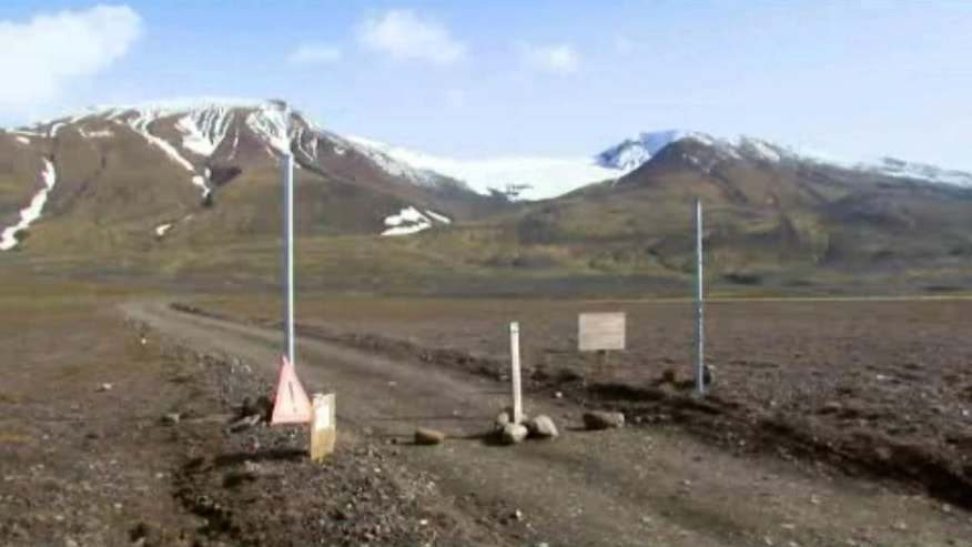 "In an in an image from an Aug. 19, 2014 video, a sign is posted on the road next to Bardarbunga, a subglacial stratovolcano located under Iceland's largest glacier. On Saturday, Aug. 23, 2014, Iceland closed airspace over the Bardarbunga volcano on Saturday after the Meteorological Office said an eruption had begun under the ice of Europe's largest glacier. The English portion of the sign reads, """"Uncertainty phase due to unrest in Bardarbunga"". (AP Photo/Courtesy Channel 2 Iceland)"