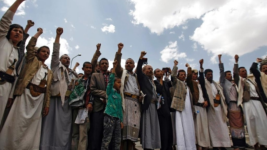 "Yemeni Shiite Hawthi rebels chant slogans demanding the government step down during a demonstration in a street leading to the Yemeni Interior Ministry in Sanaa, Yemen, Saturday, Aug. 23, 2014. Thousands of supporters of the Hawthi group, a powerful Yemeni Shiite rebel group, escalated their standoff with the government on Friday, setting up tents near three ministries to press for the replacement of Prime Minister Mohammed Salem Bassindwa who they depict as ""manipulated"" by their rival Islamist group, the Muslim Brotherhood. (AP Photo/Hani Mohammed)"