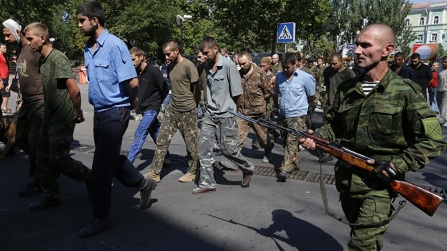 Aug. 24, 2014: Pro-Russian rebels escorting captured Ukrainian army prisoners on central square in Donetsk, eastern Ukraine. Ukraine has retaken control of much of its eastern territory bordering Russia in the last few weeks, but fierce fighting for the rebel-held cities of Donetsk and Luhansk persists.