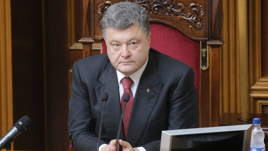 July 31, 2014: Ukrainian President Petro Poroshenko speaks to lawmakers during a session of the parliament in Kiev, Ukraine.