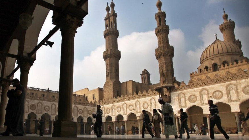 "FILE - In this Friday, Dec. 28, 2012 file photo, Muslims arrive to attend the Friday prayer at Al-Azhar mosque in Cairo, Egypt. Dar el-Ifta, the top Islamic authority in Egypt, revered by many Muslims worldwide, launched Sunday an internet-based campaign aimed particularly at the West against an extremist group in Syria and Iraq, saying it is not an ""Islamic State."" The Grand Mufti of Egypt, Shawki Allam, and clerics from the oldest Islamic learning institute, Al-Azhar, have condemned the Islamic State saying it was violating all Islamic principles and laws, describing it as a danger to the religion. (AP Photo/Khalil Hamra, File)"