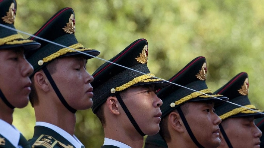 A guard of honor forms up using a line as a guide before a welcome ceremony for Zimbabwe's President Robert Mugabe outside the Great Hall of the People in Beijing, China, Monday, Aug. 25, 2014. (AP Photo/Ng Han Guan)