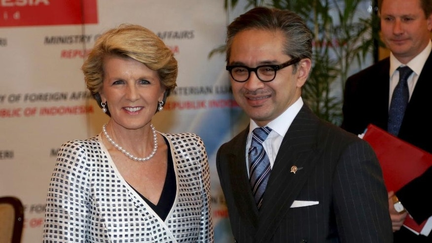 "FILE - In this Dec. 5, 2013 file photo, Australian Foreign Minister Julie Bishop, left, is greeted by his Indonesian counterpart Marty Natalegawa prior to their meeting in Jakarta, Indonesia. Australia and Indonesia have reached a new agreement on how they'll use their intelligence operations in the future, even settling their disagreement on its name. The agreement Bishop and Natalegawa are scheduled to sign Thursday, Aug. 28, 2014 on the Indonesian resort island of Bali is designed to mend a rift sparked last November by accusations that Australians tapped the cellphones of the Indonesian president, his wife and eight ministers and officials in 2009. The document with the ungainly title of ""Australia-Indonesia Joint Understanding on a Code of Conduct"" was insisted upon by the Indonesians before diplomatic relations are normalized. (AP Photo/Tatan Syuflana, File)"